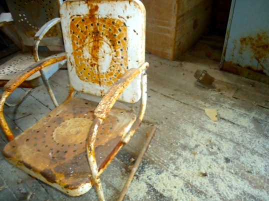 Old Chair with Corn Mill on the Floor